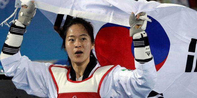 Oh Hyeri of South Korea celebrates after winning a women's Taekwondo 67-kg final at the 2016 Summer Olympics...