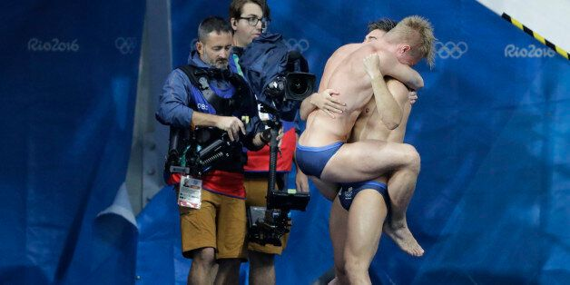 Britain's Jack Laugher and Chris Mears celebrate after winning the men's synchronized 3-meter springboard...