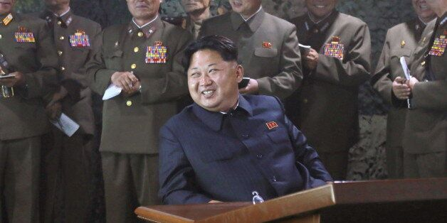 North Korean leader Kim Jong Un watches night naval fire strike drill of navy warship sub-unit and ground...