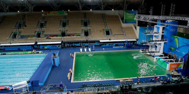The water of the diving pool at right appears a murky green, in stark contrast to the pool's previous...