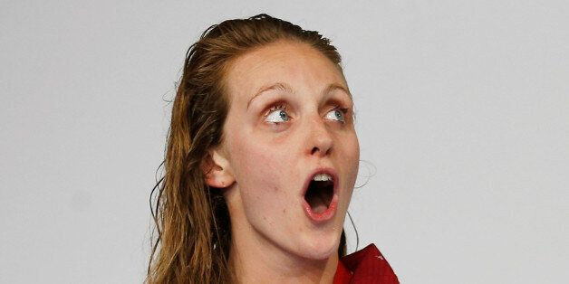 England's Francesca Halsall sings her national anthem after winning the gold medal in the women's 50m...