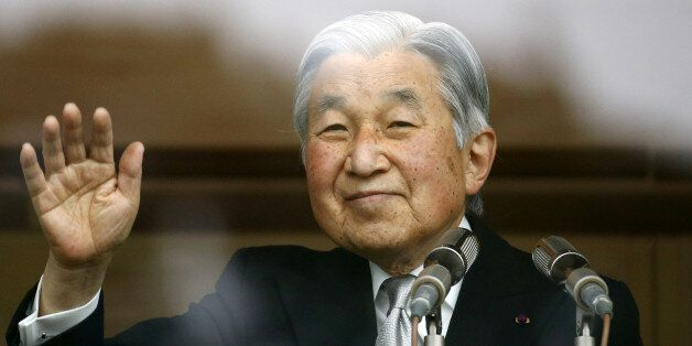 Japan's Emperor Akihito waves to well-wishers who gathered at the Imperial Palace to mark his 82nd birthday...