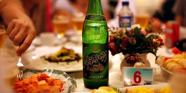 A bottle of beer is seen at a official dinner in Rajin at the Special Economic Zone of Rason City, northeast...