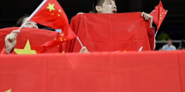 China fans watch the athletics competitions of the 2016 Summer Olympics at the Olympic stadium in Rio...