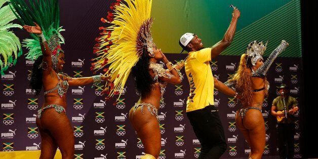 2016 Rio Olympics - Athletics - Rio de Janeiro, Brazil - 08/08/2016. Usain Bolt dances samba at a press...