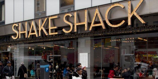 FILE - In this Friday, March 4, 2016, file photo, people walk past a Shake Shack in New York. Shake Shack...