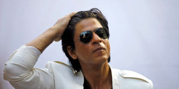 Bollywood superstar Shah Rukh Khan gestures as he speaks to the media outside his home on his birthday...
