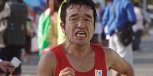Japanese-Cambodian entertainer Neko Hiroshi, whose real name is Kuniaki Takizaki, approaches the finish...