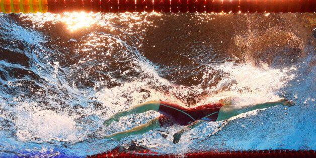 Canada's Dominique Bouchard competes during a women's 200-meter backstroke heat in the swimming competitions...