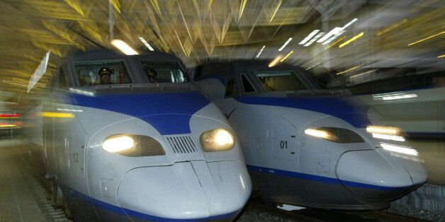 A South Korean KTX train (L) prepares to depart for Pusan city at the Seoul railway station April 1,...
