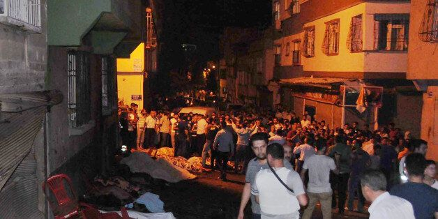 People gather after an explosion in Gaziantep, southeastern Turkey, early Sunday, Aug. 21, 2016. Gaziantep...