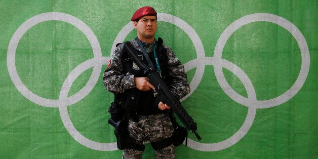 2016 Rio Olympics - Lagoa - 30/07/2016. A police officer stands at the Olympic rowing venue. REUTERS/Stefan...
