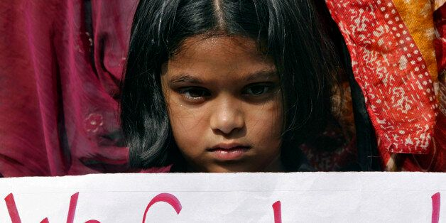A girl holds a placard as she takes part in a protest rally in the southern Indian city of Hyderabad...