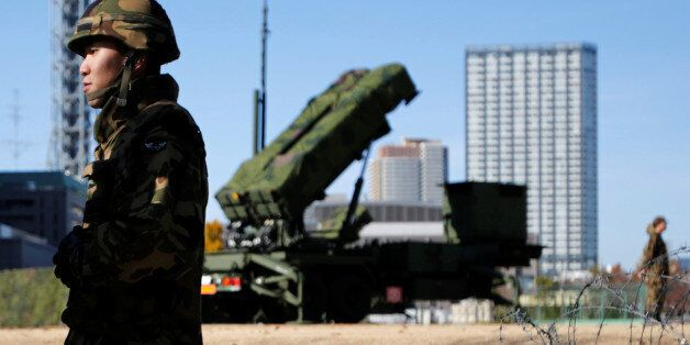 FILE PHOTO - Members of the Japan Self-Defence Forces stand guard near Patriot Advanced Capability-3...