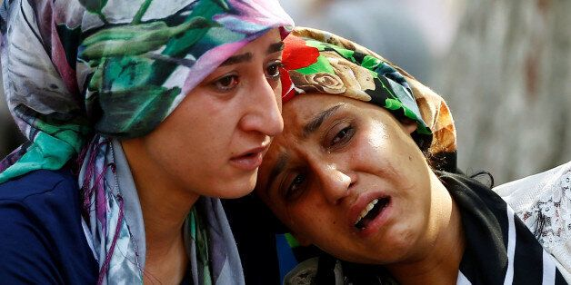 Women mourn as they wait in front of a hospital morgue in the Turkish city of Gaziantep, after a suspected...