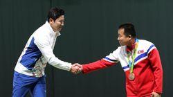 북한 사격선수 김성국은 '하나의 조선'을