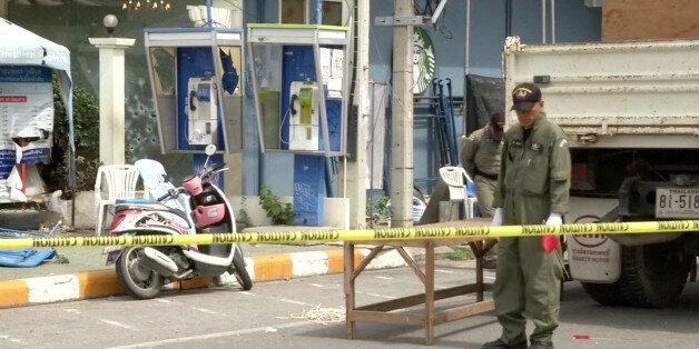 Police Explosive Ordnance Disposal (EOD) official inspects the site of a bomb blast in Hua Hin, south...
