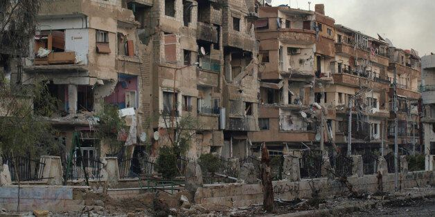 Buildings damaged by what activists said was shelling by forces loyal to President Bashar al-Assad in...