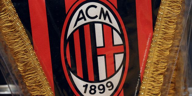 The AC Milan logo is pictured on a pennant in a soccer store in downtown Milan, Italy April 29, 2015....