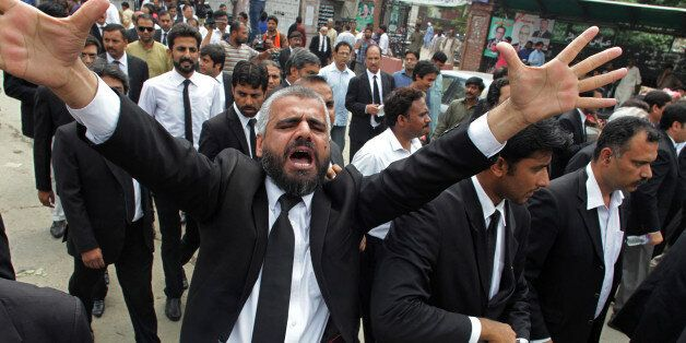 A Pakistan lawyer shouts slogans during a demonstration to condemn a suiciding bombing in Quetta that...