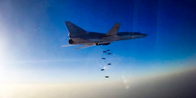 In this frame grab provided by Russian Defence Ministry press service, Russian long range bomber Tu-22M3...