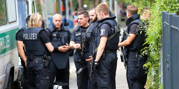 Special police stand outside the university clinic in Steglitz, a southwestern district of Berlin, July...