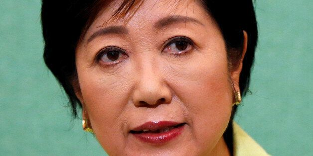 Former defense minister Yuriko Koike, a candidate planning to run in the Tokyo Governor election, attends...