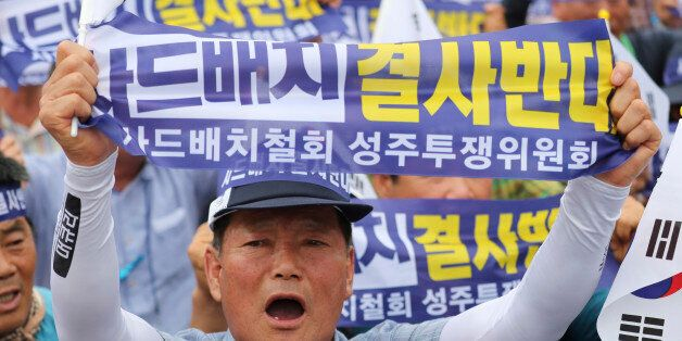 A resident in a rural South Korean town shouts slogans protesting a plan to deploy an advanced U.S. missile...