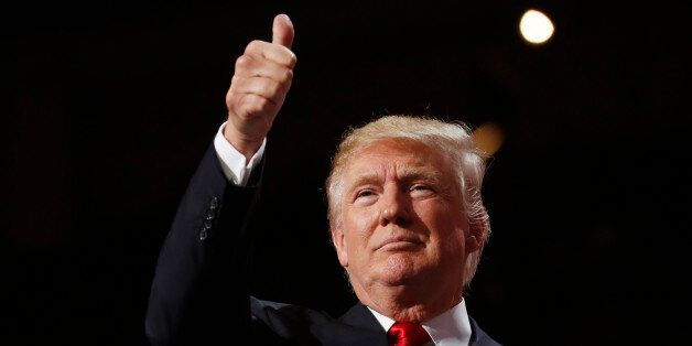 U.S. Republican presidential nominee Donald Trump gives a thumbs up at the Republican National Convention...