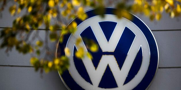 FILE - In this Oct. 5, 2015, file photo, the VW sign of Germany's Volkswagen car company is displayed...