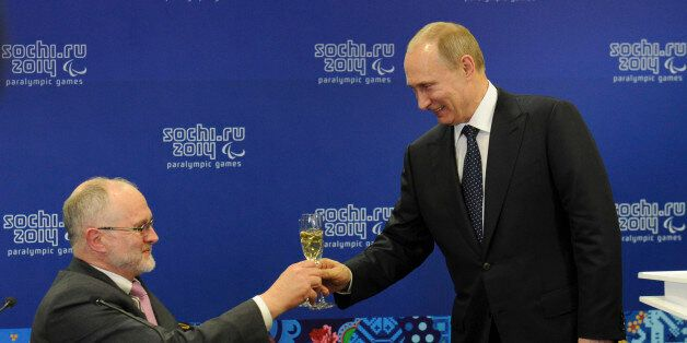 Russia's President Vladimir Putin (R) toasts with President of the International Paralympic Committee...