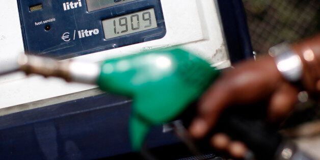An attendant prepares to refuel a car at a petrol station in downtown Rome March 13, 2012. Current world...