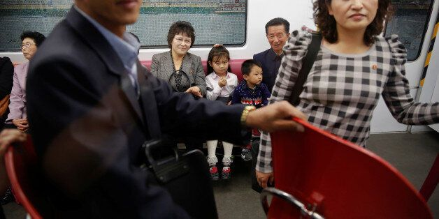 Passengers travel on a recently introduced new train during a government organised visit to the subway...