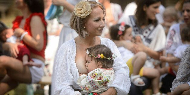 A woman breastfeeds her eighteen-month-old daughter Anastasia at an event promoting the freedom of mothers...