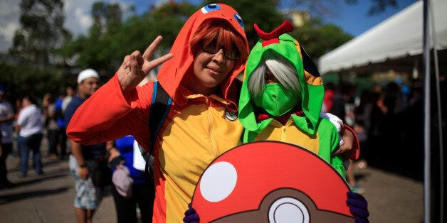 Cosplayers dressed as characters of the augmented reality mobile