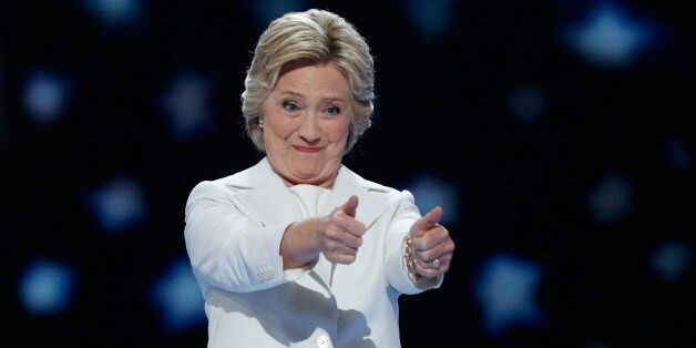 Democratic presidential nominee Hillary Clinton gives two thumbs up as she arrives to accept the nomination...