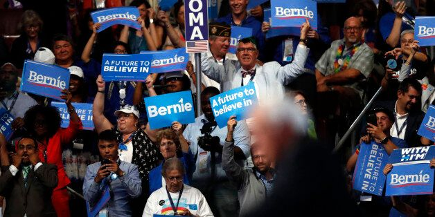 Supporters cheer as former Democratic Presidential candidate, Sen. Bernie Sanders, I-Vt., speaks during...