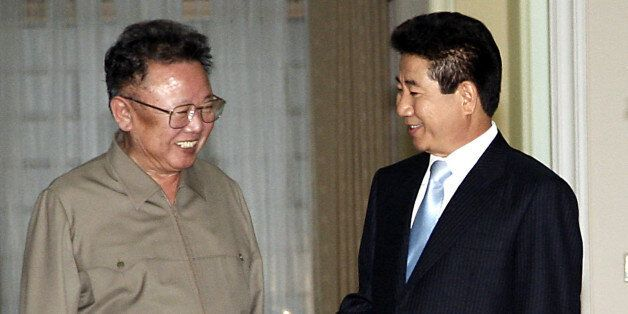 North Korean leader Kim Jong-il (L) talks with South Korean President Roh Moo-hyun before their inter-Korean...