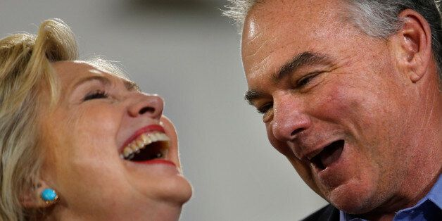 Democratic U.S. presidential candidate Hillary Clinton and U.S. Senator Tim Kaine (D-VA) react during...