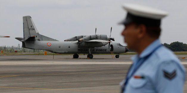 An Indian Air Force (IAF) AN-32 aircraft stands on the tarmac of Yelahanka air base ahead of Air Force...