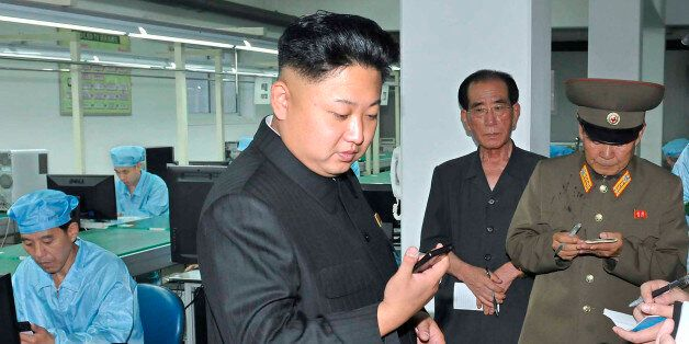 North Korean leader Kim Jong-Un visits the May 11 Factory in this undated photo released by North Korea's...