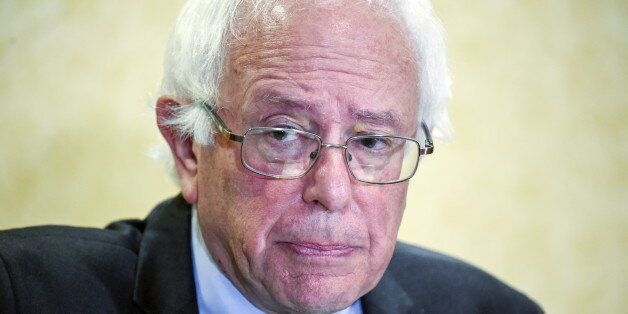 Democratic presidential candidate and U.S. Senator Bernie Sanders takes reporters questions during a...