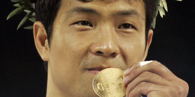 Dae Sung Moon, from Korea, displays his gold medal after defeating Alexandros Nilolaidis, from Greece,...