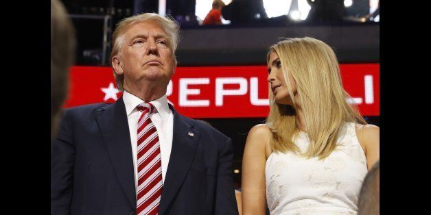 Republican U.S. presidential nominee Donald Trump stands in the Trump family box with his daughter Ivanka...