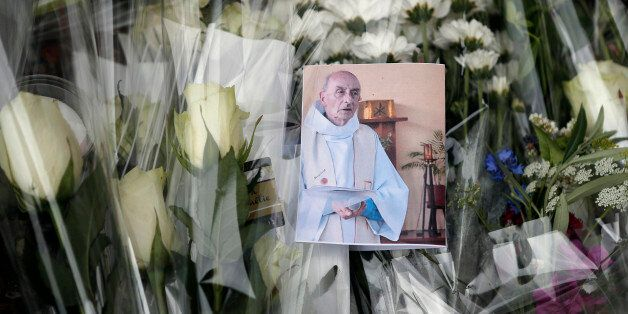 A picture of late Father Jacques Hamel is placed on flowers at the makeshift memorial in front of the...