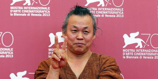 Director Kim Ki-duk poses during a photocall for his