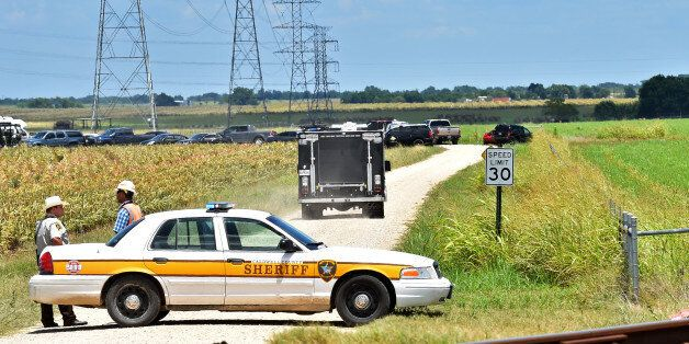 Authorities head down a dirt road toward to investigate the scene of a hot air balloon crash that left...