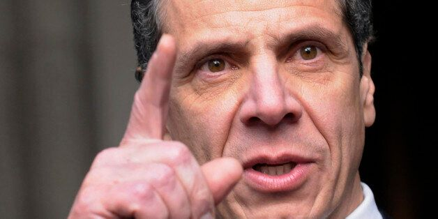 New York Governor Andrew Cuomo talks with reporters after his public inauguration ceremony at the state...