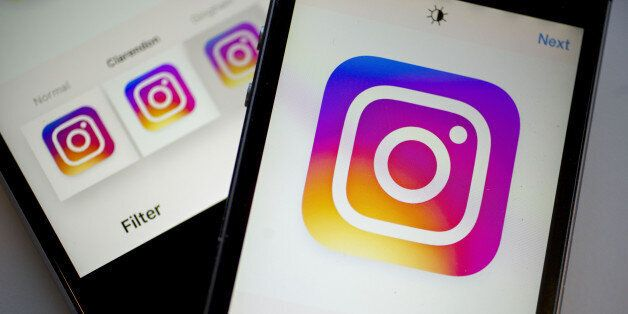 Facebook Inc.'s Instagram logo is displayed on the Instagram application on an Apple Inc. iPhone in this...