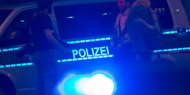 Policemen block the scene of a shooting with a large section of the surrounding area in Munich, Germany,...